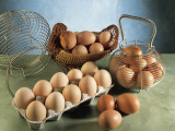 High Angle View of Eggs in Baskets and a Carton Fotografisk trykk av P. Martini