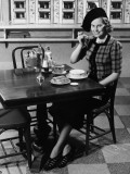 Woman in Fancy Hat Eating Breakfast in Bar Photographic Print by George Marks