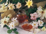 Close-Up of a Jar of Honey with Roses Photographic Print by P. Martini