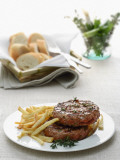 Close-Up of a Hamburger with Herbs and French Fries Photographic Print