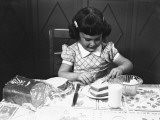 Girl (6-7) Spreading Butter on Slice of Toast Reproduction photographique par George Marks