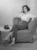 Woman Sitting on Armchair, Talking on Phone, (B&W), Photographic Print by George Marks