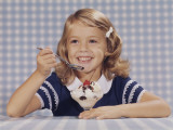 Girl Smiling Eating an Ice Cream Sundae Photographic Print by Dennis Hallinan