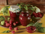 Close-Up of Raspberries with Two Jars of Raspberry Jam Photographic Print by P. Martini