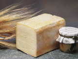 Close-Up of Cheese (Tilsit Cheese) with Wheat and a Covered Jar Reproduction photographique par G. Cigolini