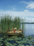Retro Boy Pole Fishing in Lake Inside Canoe Photographic Print by Dennis Hallinan