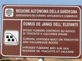 Close-Up of a Sign Board, Domus De Janas, Sardinia, Italy Photographic Print by W. Buss