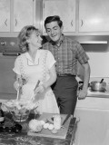 Mid Adult Couple in Kitchen, Woman Preparing Salad Photographic Print by George Marks