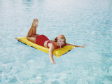 Happy Woman Sun on Bathing Inflatable Pool Raft Photographic Print by Dennis Hallinan
