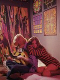 Hippie Couple in Psychedelic Bedroom Photographic Print by Dennis Hallinan