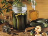 Close-Up of Pickled Courgettes in a Glass Jar with Vegetables Photographic Print by P. Martini