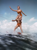 Couple Waterskiing Together Photographic Print by Dennis Hallinan