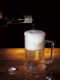 Close-Up of Beer Pouring from a Bottle into a Glass Photographic Print by G. Majno