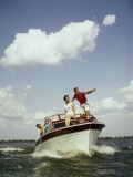 Couples Enjoy Speed Boat Ride Photographic Print by Dennis Hallinan