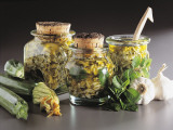 Close-Up of Courgettes in Jars of Vinegar Oils Photographic Print by N. Banas