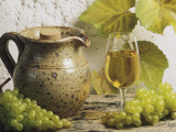 Close-Up of a Glass of White Wine with a Bunch of Grapes Photographic Print by G. Cigolini