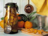 Close-Up of Orange Rinds for Punch Preparation with a Bottle of Pickle Photographic Print by N. Chasseriau