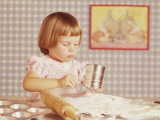 Girl Sifting Flour for Cupcakes Photographic Print by Dennis Hallinan