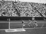 Track Athletes Running on Track, (B&W), Elevated View Photographic Print by George Marks