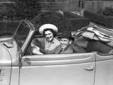 Couple Riding in Old Fashion Convertible Car Photographic Print by George Marks