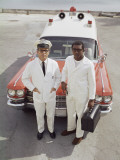 Two Paramedics Stand in Front of Ambulance Photographic Print by Dennis Hallinan