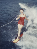 Happy Retro Woman Water Skiing Photographic Print by Dennis Hallinan