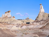 Clouds Drift Past Capped Rock Towers in Badlands Photographic Print by Jeff Foott
