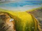Rainbow Pool and Algae Add Color to Black Sand Geyser Basin Photographic Print by Jeff Foott