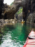Sea-Kayaking on Water around Volcanic Caves Photographic Print by Ippei Naoi