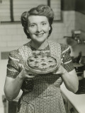 Portrait of Mature Woman Holding Pie Photographic Print by George Marks