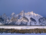 View of Grand Teton Mountain Range in Winter Photographic Print by Jeff Foott