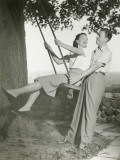 Couple Playing on Tree Swing Photographic Print by George Marks