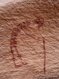 Detailed Pictograph of Arthritic Man with Cane Carved in Stone Photographic Print by Jeff Foott