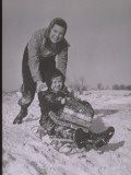 Girl Pushes Child on Sled with Christmas Gifts Fotografie-Druck von Lambert 