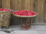 China, Sichuan Province, Drying Red Pepper in Basket Photographic Print by Keren Su
