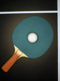 Table Tennis Racquet and Ball on Table, Overhead View Photographic Print