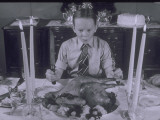 Boy Sits Dow to Thanksgiving Dinner Fotografie-Druck von Lambert 