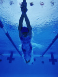 Female Swimmer Diving into Pool, Underwater View Photographic Print