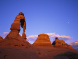 Moon Looms over Delicate Arch Photographic Print by Jeff Foott