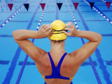 Female Competitive Swimmer Adjusting Goggles over Swim Cap, Rear View Photographic Print