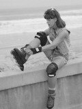 Woman Putting on Rollerblades Wearing Skating Gear Photographic Print