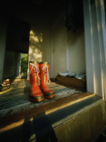 Red Rubber Boots in a Window Photographic Print by Lena Johansson