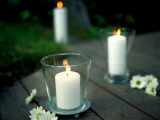 Lit Candles in Glass Candleholders Photographic Print