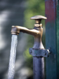 A Faucet and Running Water Photographic Print