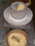 China, Zhejiang Province, Wuzhen, Millstone with Basket of Soybeans Photographic Print by Keren Su
