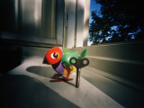 A Toy Bird and a Windup Key Photographic Print by Lena Johansson