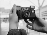 Person Taking Self-Portrait with Vintage Camera Photographic Print