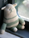 Knitted Green and White Cat on Windowsill Photographic Print by Lana Stewart