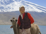 China, Xinjiang Province, Kyrgyz Girl with Baby Camel by Karakuli Lake, Mt Photographic Print by Keren Su