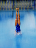 Woman Diving into Pool Photographic Print